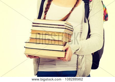 Teenage woman with backpack and books.
