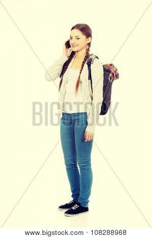 Happy teen woman talking on the phone.