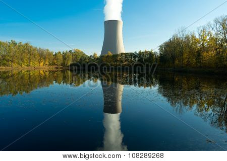 Nuclear Power Plant Next The Pond And Its Reflection In Water