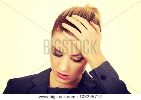 Worried business woman touching her head.