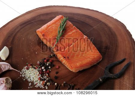 breakfast delicious portion of fresh roast salmon fillet dry spices garlic rosemary wooden plate black forged handmade fork healthy food diet cooking concept isolated on white background empty space