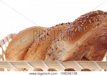 three different bagels in basket isolated over white background