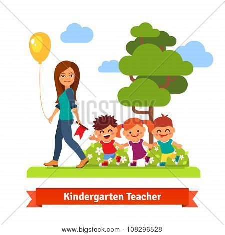 Kindergarden teacher walking with kids