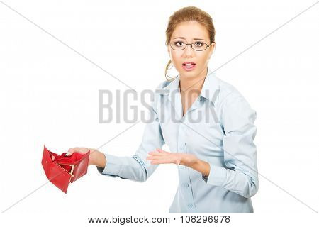 Unhappy businesswoman holding empty purse.
