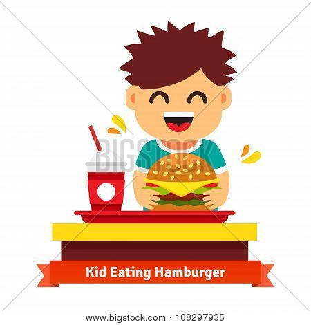 Kid eating and drinking at fast food table