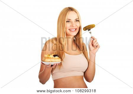 Pregnant woman eating prickles and cake