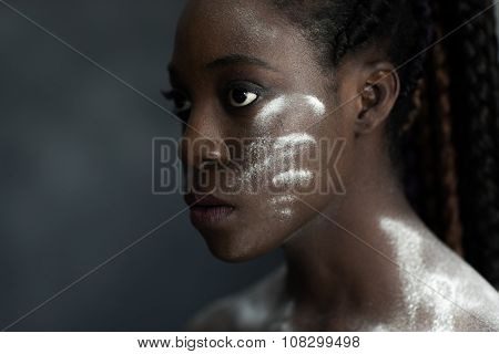 Black Human Skin With Wite Stripes Of Powder