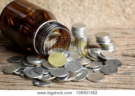 Coins In Glass Bottle