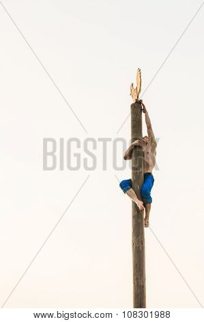 GOMEL, BELARUS - February 21, 2014: Young man climbs on a wooden