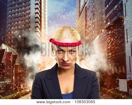 Furious businesswoman with a red bandage in the city