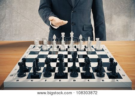 Businessman Invites To Play A Chess Game
