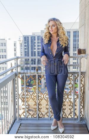 A blonde model posing outdoors on a balcony
