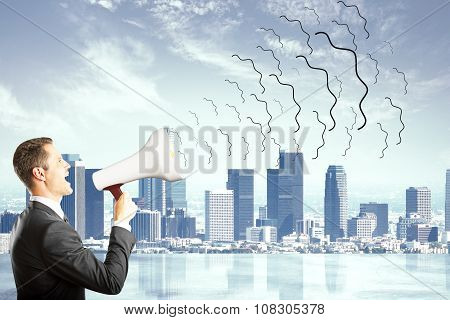 Businessman With Magaphone Shouting At City Background