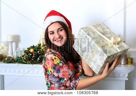 Beautiful Happy Girl Holding A Box With Christmas Gift