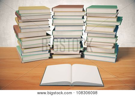 Piles Of Book And Opened Blank Diary On A Wooden Table