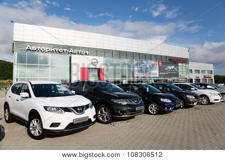 ARTYOM, RUSSIA - CIRCA AUGUST, 2015: Cars at the dealership of Nissan for the city of Vladivostok. Nissan Motor Co., Ltd. - Japanese automaker, one of the largest in the world and the third in Japan.