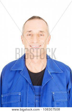 Smiling mature repairman in uniform.