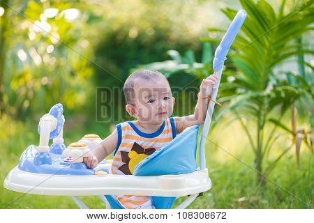 Asian Baby In The Baby Walker