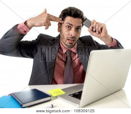 Attractive Businessman Sitting At Office Desk Working Stressed On Computer Laptop Holding Mobile Pho