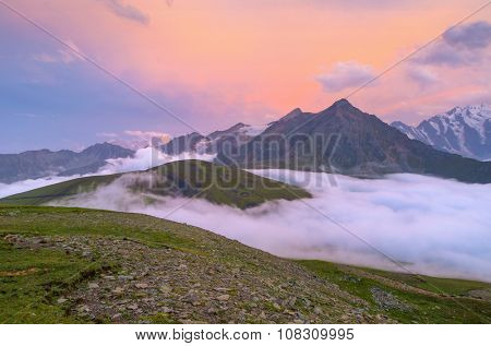 Sunset over cloudy walley at Caucasus mountains