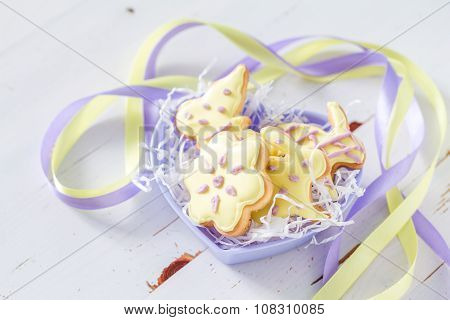 Easter cookies in heart shaped bowl