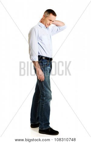 Fashionable mature man with neck pain.