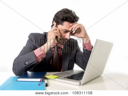 Busy Businessman Working In Stress On Computer Laptop Talking On Mobile Phone