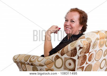 Smiling Senior Woman Sitting On Couch