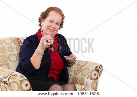 Senior Woman At Her Seat Inviting To Have A Tea