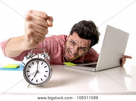 Crazy Businessman Switching Off Alarm Clock Sitting At Office Desk Working With Computer Laptop In D