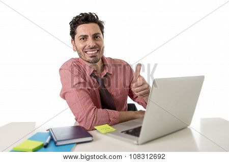 Attractive Businessman In Shirt And Tie Sitting At Office Desk Working With Computer Laptop Giving T