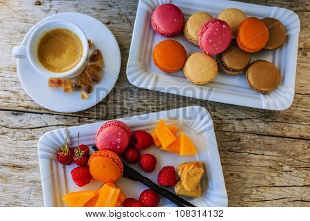 Macaroons - espresso and French dessert, colorful almond cookies with different fruit flavors