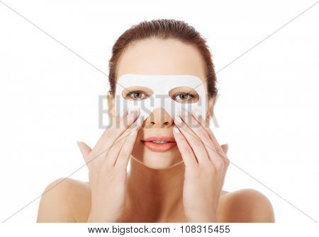 Beautiful woman with collagen mask on face.