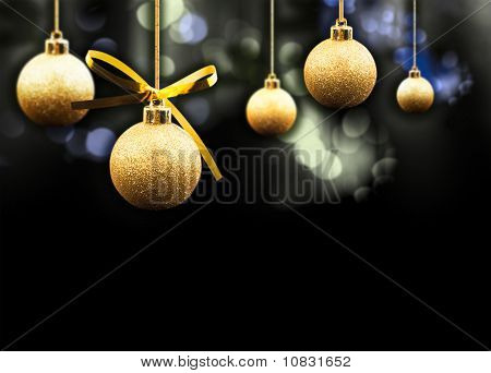 Gold Christmas Balls On A Multi Coloured Sparkling Background