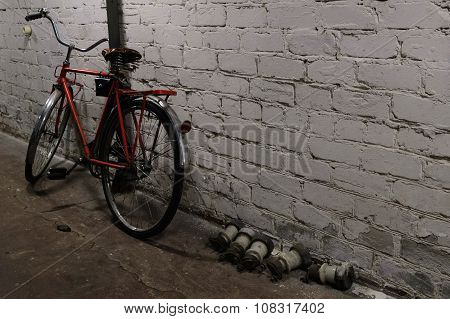 Old city bicycle and white brick wall