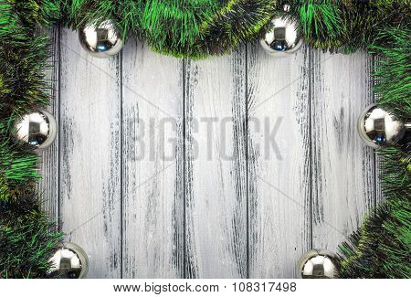 New Year Theme Christmas Tree Green Decoration And Silver Balls On White Retro Stylized Wood Backgro
