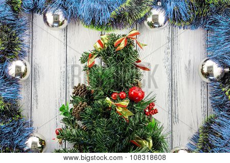 New Year Theme Christmas Tree With Blue, Red And Green Decoration And Silver Balls On White Retro St