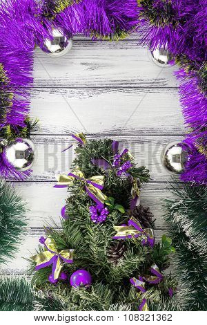 New Year Theme: Christmas Tree With Violet And Green Decoration And Silver Balls On White Retro Styl