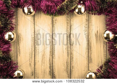 New Year Theme Rose And Green Christmas Tree Decoration And Silver Balls On Retro Stylized Wood Back