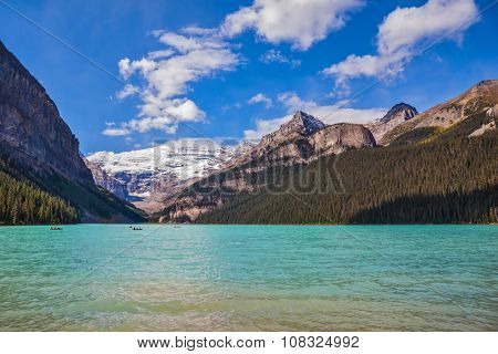 Banff National Park, Canada, Alberta. Magnificent Lake Louise with emerald water surrounded by the Rocky Mountains and glaciers