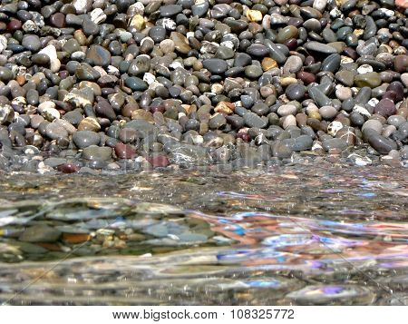 Stones On Background Of Sea Water With Reflections
