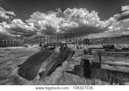 Wreck of a ancient rusty car in a ghost town of Bodie. Bodie is a National Historic Landmark. It is located in Mono County, Sierra Nevada - California. United States of America.