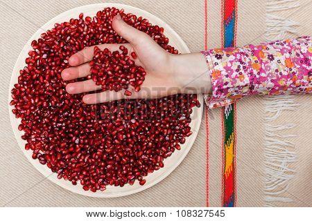 Full plate of peeled pomegranate seeds