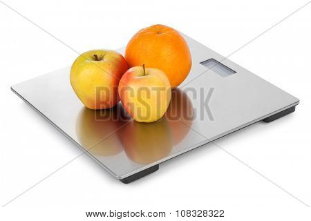 Weight scale and fruits isolated on white background