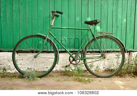 Old Bicycle Single Speed Parked Against Wall Of The House