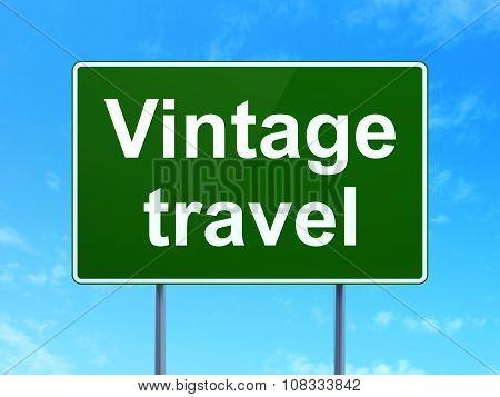 Travel concept: Vintage Travel on road sign background
