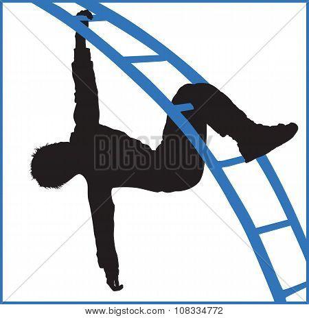 Boy Climbing A Jungle Gym At The Park