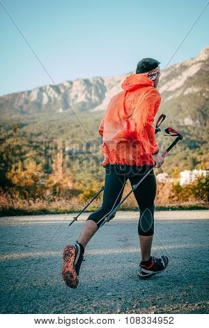young athlete man running mountain marathon on road