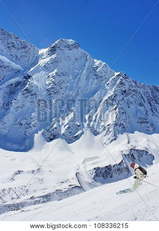 A skier in mountains