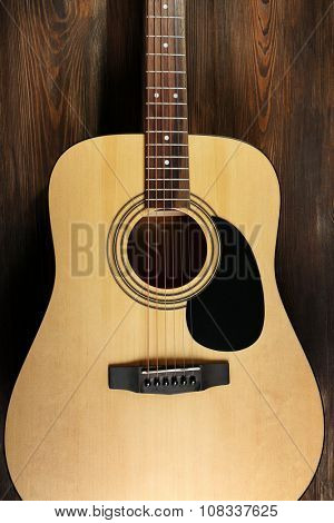 Guitar on wooden background